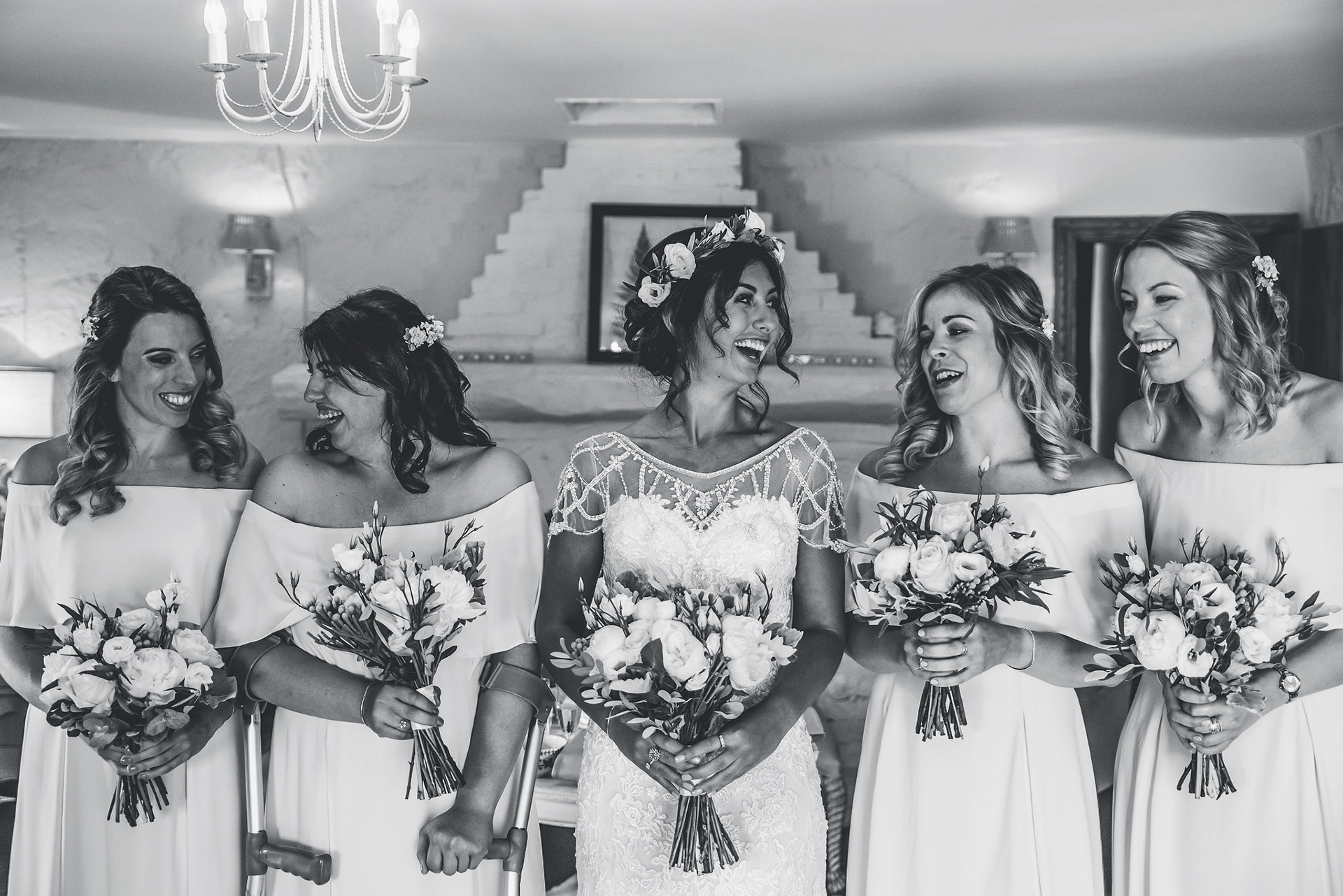 The happy bride and her bridesmaids have a wedding photo before wedding ceremony
