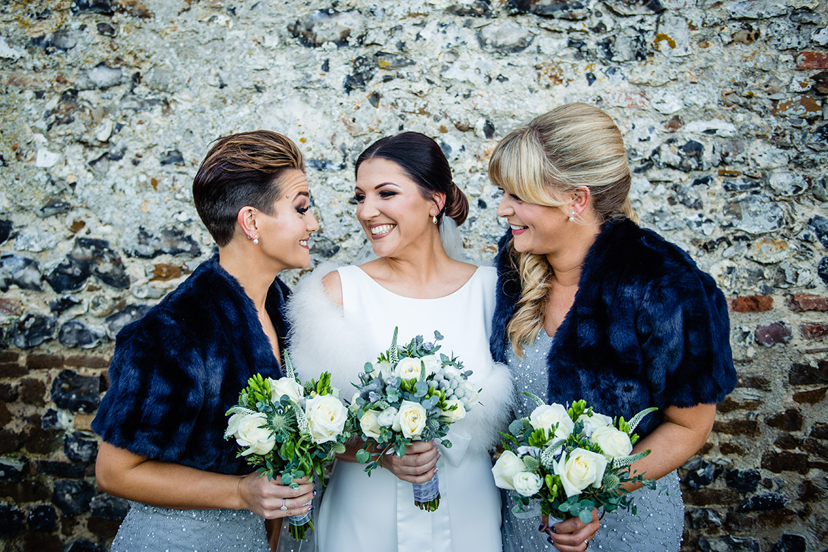 The bride and her bridesmaids wear faux boleros at this winter wedding at Pentney Abbey in Norfolk