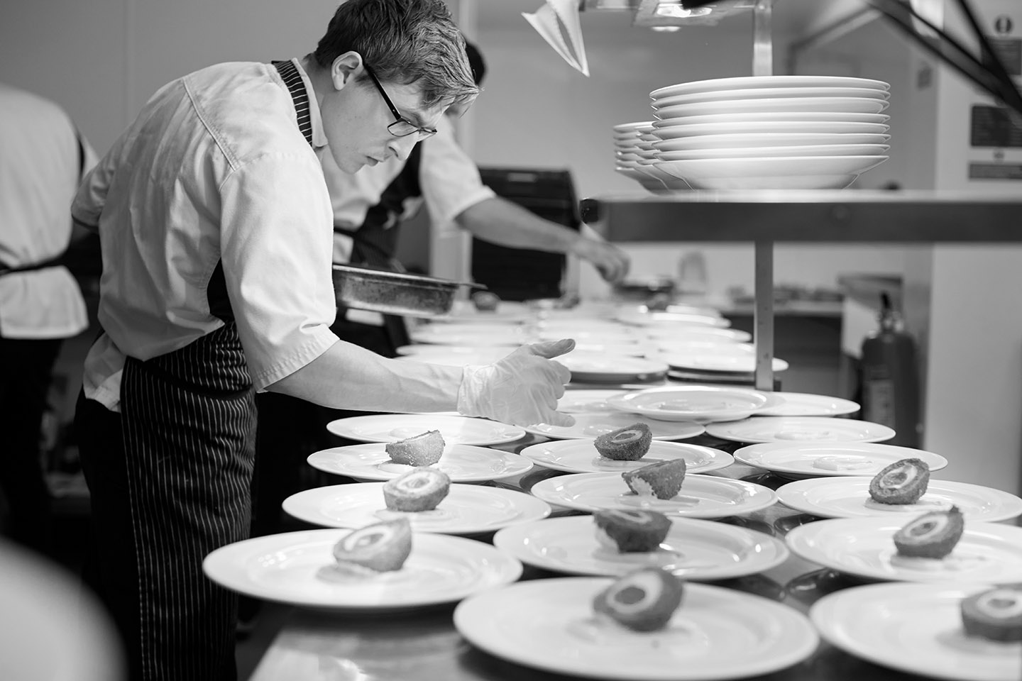 A chef prepares wedding food at Pentney Abbey in Norfolk