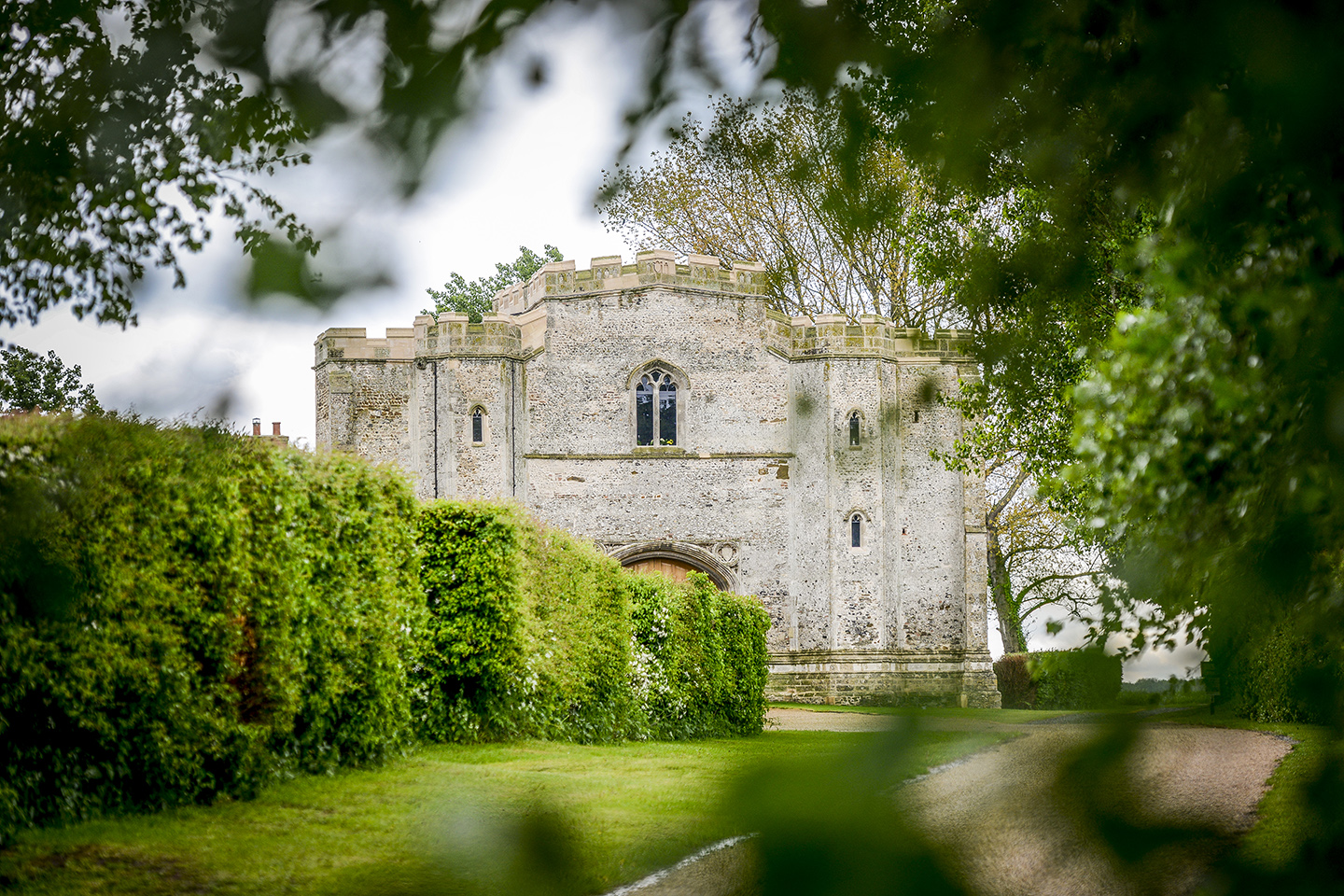 The historic gatehouse at Pentney Abbey is the perfect setting for a wedding ceremony