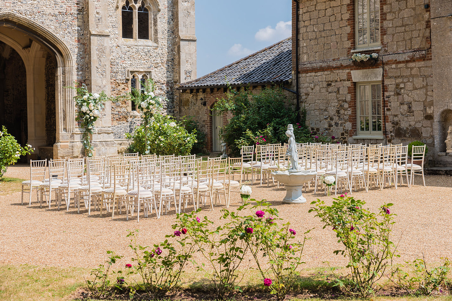The rose garden at Pentney Abbey is the perfect setting for an outdoor wedding ceremony